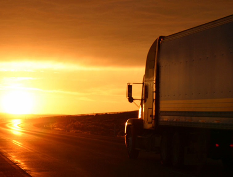 Semi driving off into sunset