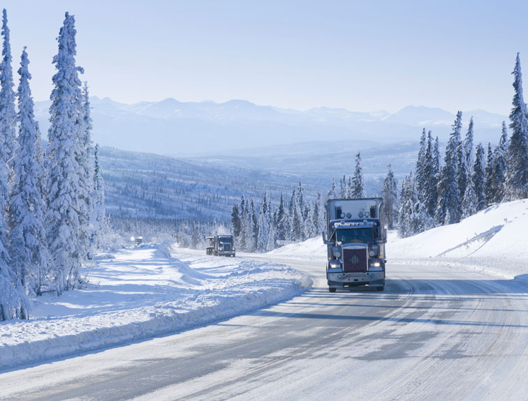 Semi driving down road in winter