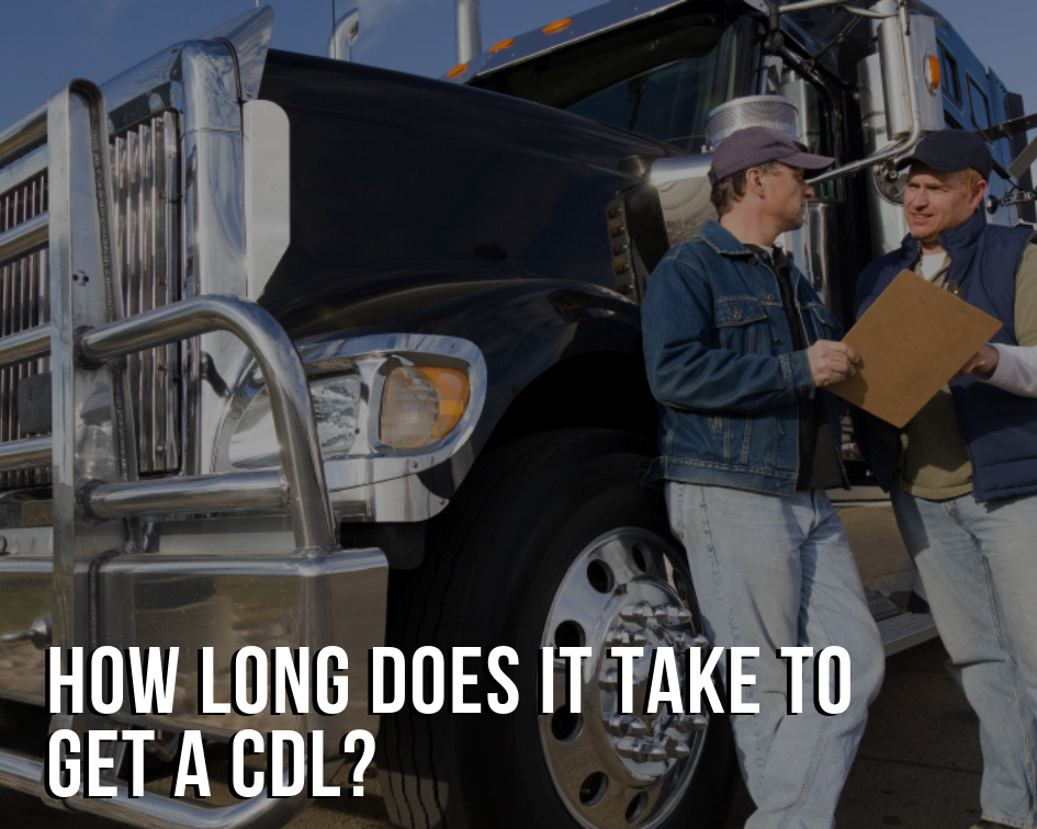 How Long Does it Take to Get a CDL image with people standing next to a truck in background