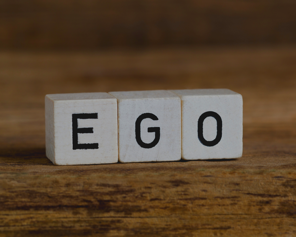 E, G, O blocks with a wood background